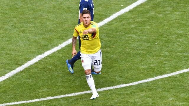 El festejo deQuintero, que ingresó a último momento por James Rodríguez, en el gol que le da vida a Colombia en su debut en la Copa del Mundo (AFP PHOTO/Mladen ANTONOV)