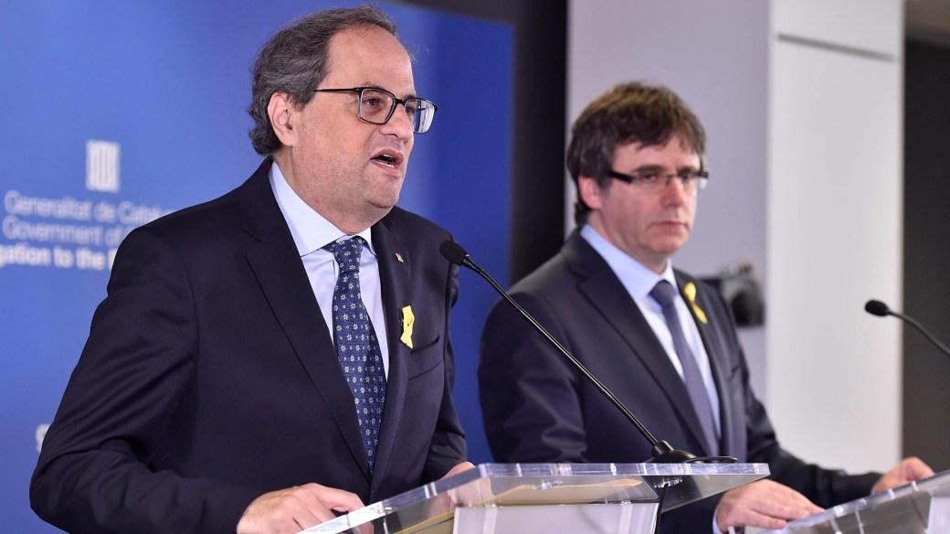 Puigdemont junto a Quim Torra en Bruselas este sábado (Reuters)