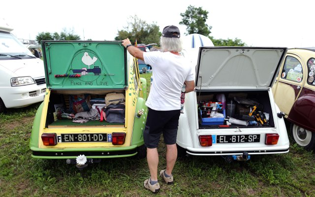 A man standing next to a Citroen 2CV in Samobor, Croatia.  (Reuters)