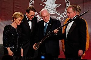 Straight Shooter: National Rifle Association official Sandra Froman (far left) watches as former Vice President Dick Cheney inspects a rifle at the gun rights group?s convention.