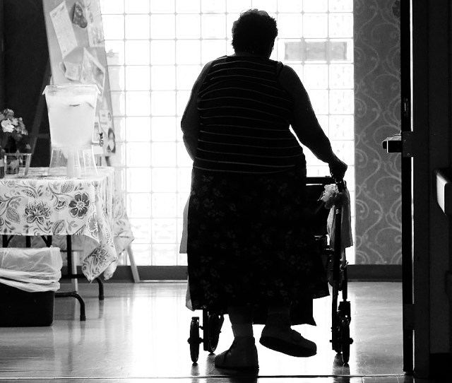 A Resident Walks Down A Hallway At Emerald South Nursing And Rehabilitation Center On Delaware