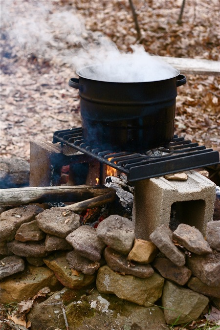 boiling-down-maple-sap-over-fire