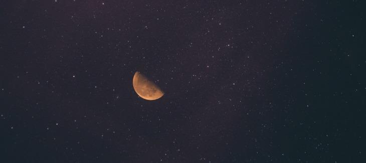 Half moon against a dark sky