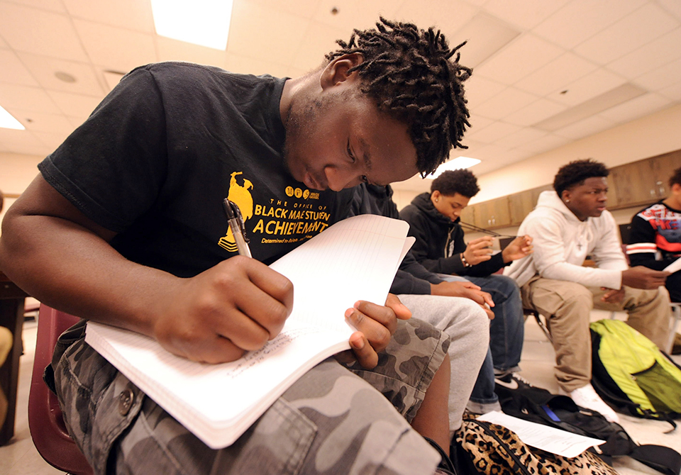 photo of student writing in notebook