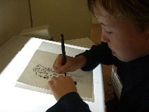 Child Tracing a Picture