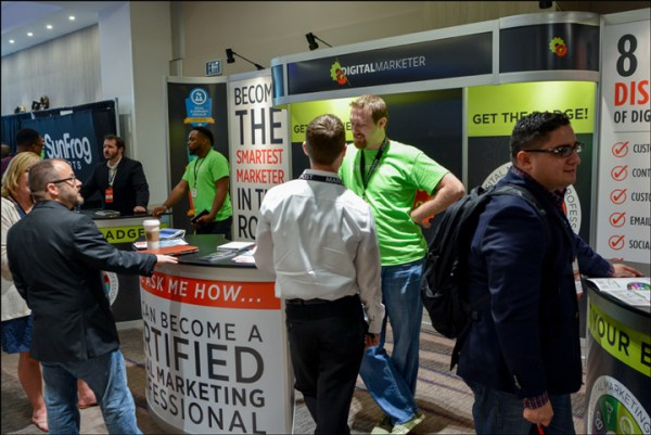 The DigitalMarketer Booth manned by DM employees from a previous Traffic & Conversion Summit