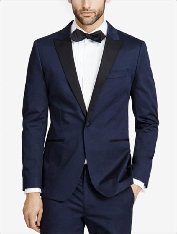 A man modeling a navy blue suit