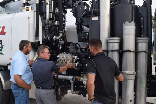 Jared Wilson (R), environmental specialist, Great Southern Equipment Company, discusses the automatic continuous filter system.