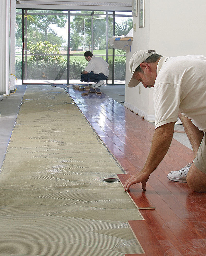glue wood flooring to a concrete slab