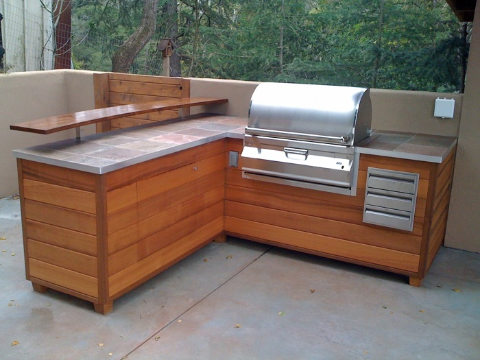 An Outdoor Barbeque Island That Looks Like Wooden ... on Diy Patio Grill Island id=82579