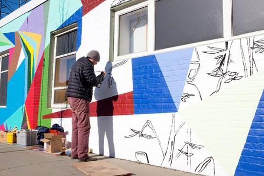 """Evo"" Mural Creates Vibrant Visual Masterpiece on Western Ave."