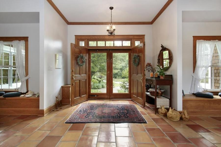 199 Foyer Design Ideas for 2018  All Colors  Styles and Sizes  One story foyer with brown tile floor opening up to the left and right of