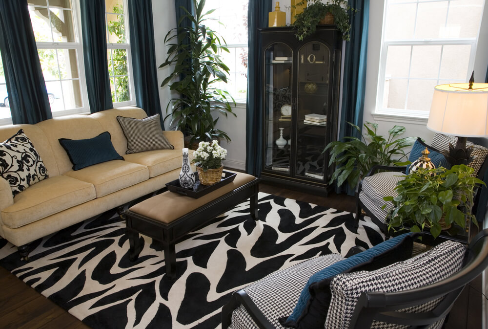25 Cozy Living Room Tips and Ideas for Small and Big Living Rooms The black and white patterned rug sets the dramatic design foundation for  this cozy living room