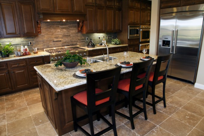 Large Marble Topped Island With Dining E Centers This Kitchen Over Beige Tile Flooring