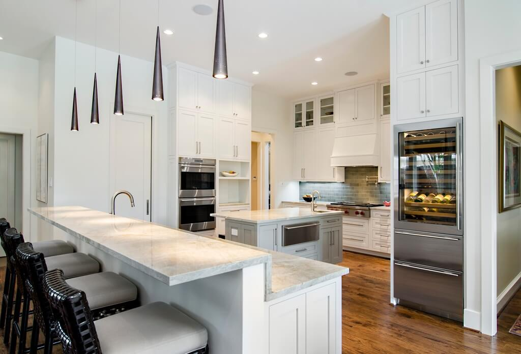 30 Custom Luxury Kitchen Designs that Cost More than  100 000 White kitchen with very tall cabinets  floor to ceiling   The amount