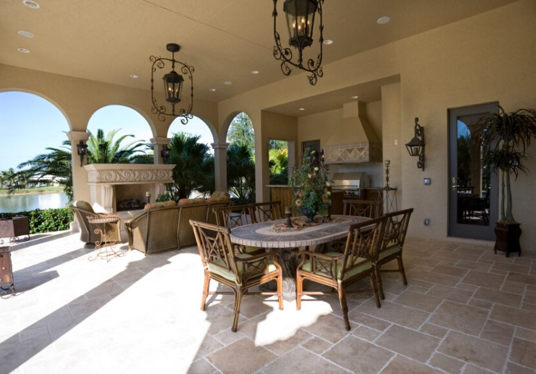 55 Luxurious Covered Patio Ideas  Pictures  This incredibly spacious covered patio features a small outdoor kitchen  a  large formal dining table