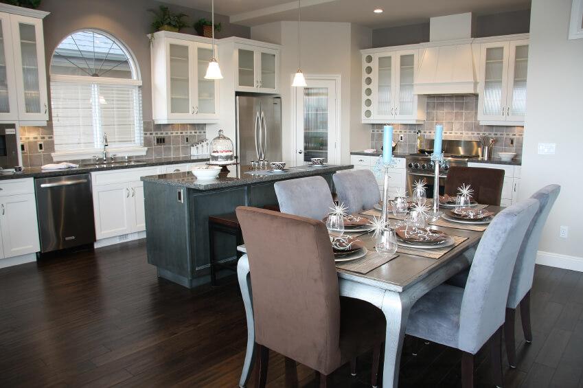 White kitchen with dark hardwood flooring.