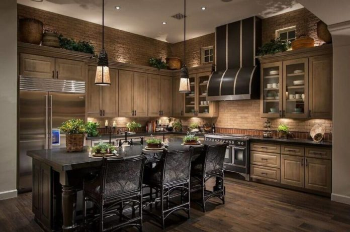 Pendant lights with shades, like the ones above, create a more direct source of light onto the workspace of the island below them. This offers great lighting for the center of the kitchen, but requires more lighting around the perimeter of the room to light the entire kitchen.