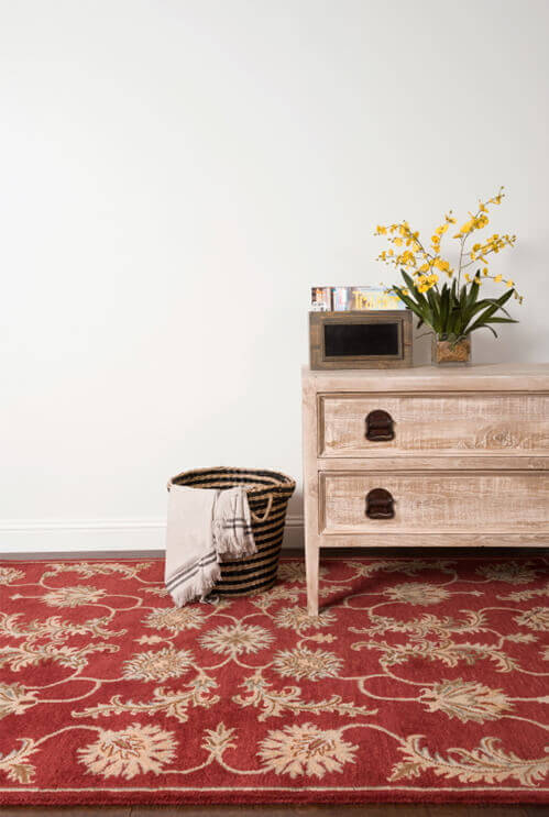Stylish for both modern and traditional design schemes, this red rug brings a pop of color into an entryway or bedroom.