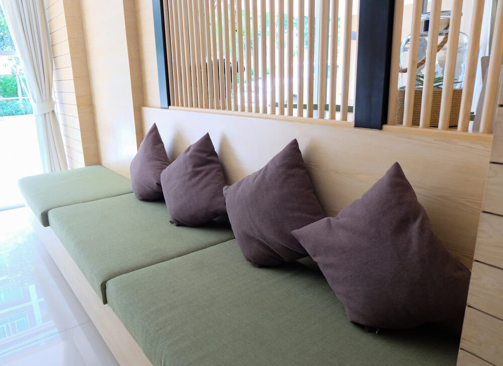 Example of built-in sofa where the purple throw pillows form the cushioned back.