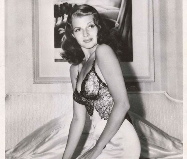 Rita Hayworth In Sheer Topped Black Lace Nightgown Kneels On Bed