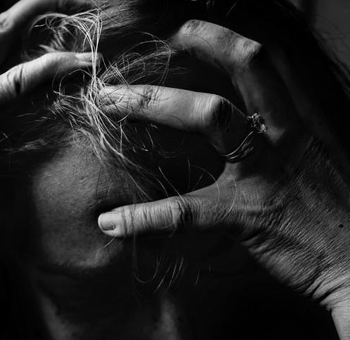A Black And White Image Of A Upset woman - Self Help For Panic Attacks