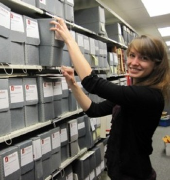 A librarian organizes the Potsdam archives