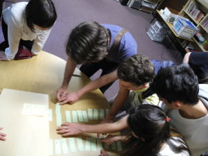Students working on Montessori material