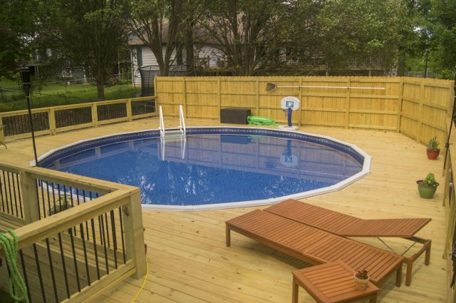 Wooden pool deck built by TrueSon Exteriors