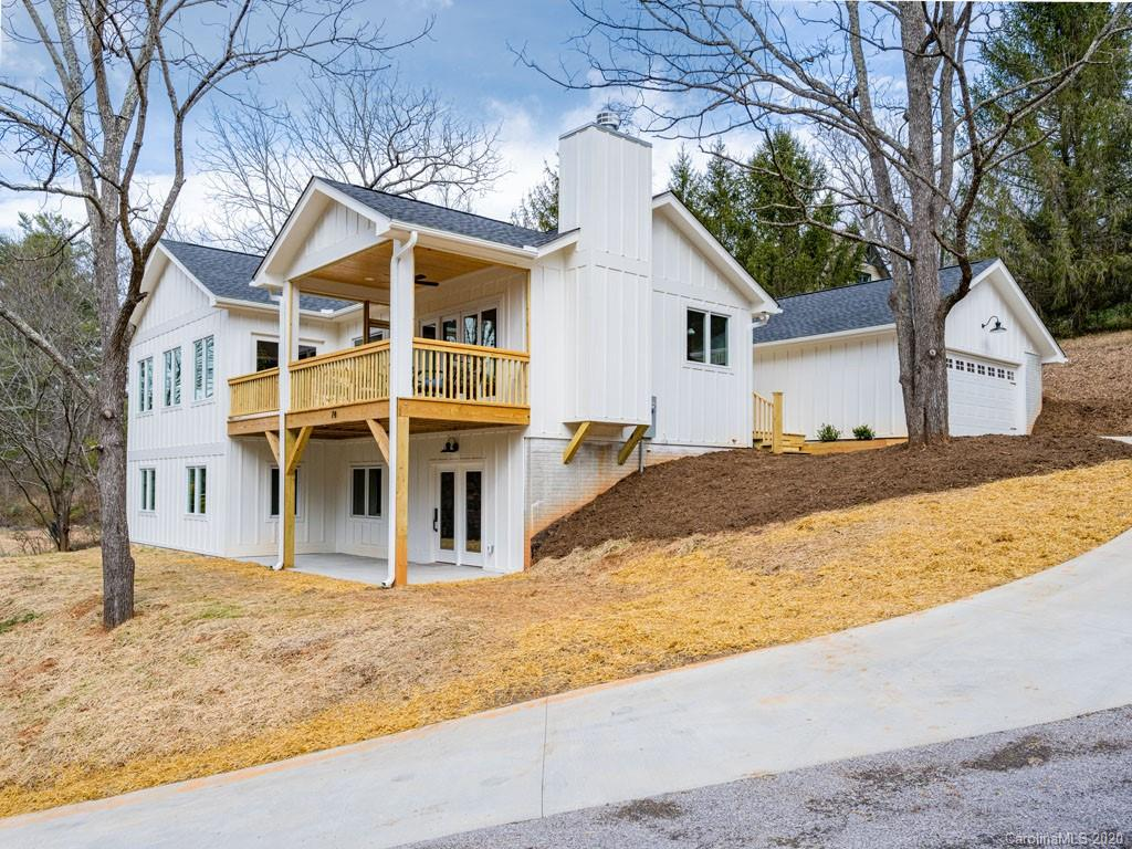 New construction - modern farmhouse in peaceful Beaverdam neighborhood, very convenient to everything in North Asheville. Three bedrooms, two and a half baths, lower level bonus/office space, detached two-car garage, screened porch plus upper and lower level decks. Designer kitchen with sophisticated granite countertops, island for utility and entertaining plus open to the living area. Soaring stacked stone fireplace in the living room with convenient access to outdoor living spaces. Oversized master bedroom on main level with gorgeous en suite bathroom. Lower level features two guest bedrooms plus an additional full bathroom. Deck on lower level so guests can enjoy the mountain lifestyle. Quiet street imparts sense of serenity just minutes to restaurants, shopping and entertainment.