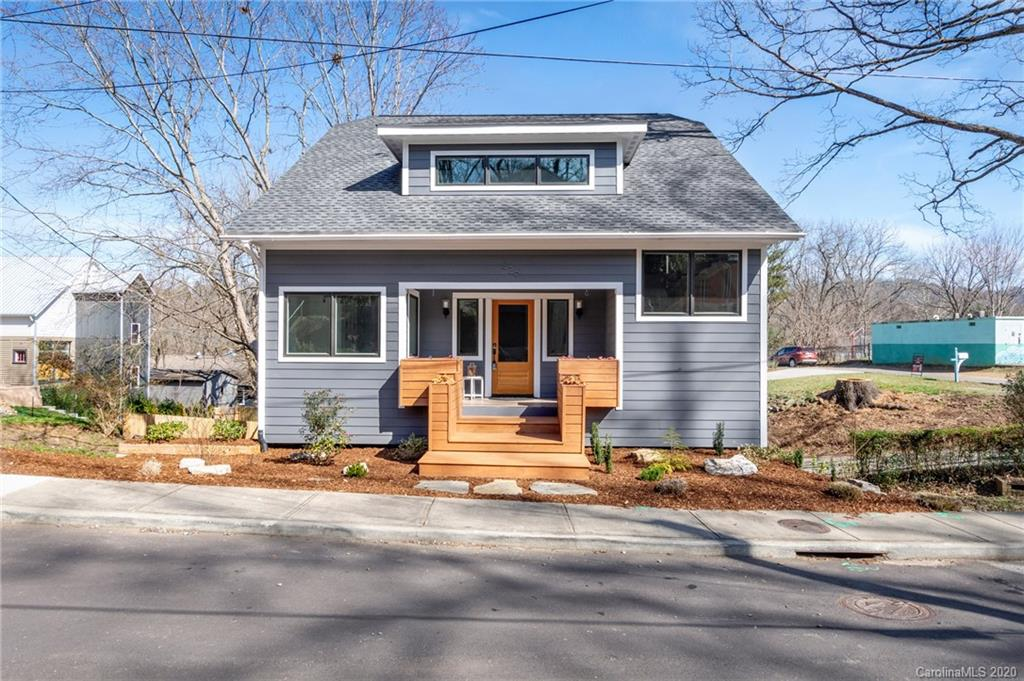 Beautiful newer construction in the popular Montford neighborhood walkable to downtown and adjacent to the Flint St park. Two homes in one with a 2-level main house + lower level apartment with a separate entrance. Preserving only elements of the original foundation, the home was completely rebuilt in 2017 with a new construction permit. Primary home features single level living with a master suite and laundry on the main. Master has a private deck and an ensuite full bathroom that includes a dual vanity, tiled shower and modern fixtures. Kitchen features leathered granite counters, black stainless appliances, soft-close cabinets and a stunning kitchen island. Elegant cable-rail stairs leads to a giant loft/separate living area with a built-in desk and reading nook + 2 beds and 1 bath upstairs. Well appointed 2 bed apartment is separately metered and features a large living area, granite/stainless kitchen, and hardwood floors. Perfect for income or extended family/guests.