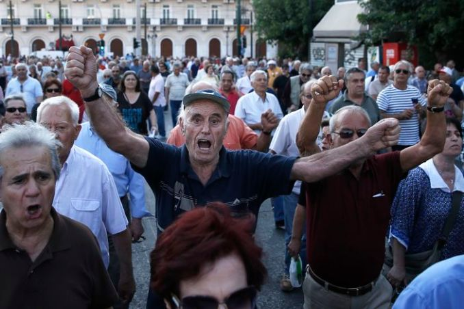 "Pensioners chant slogans during an anti-austerity protest  in Athens, Tuesday, June 23, 2015. Greece's government defended Tuesday the billions worth of ""harsh"" new budget savings it has offered in talks with creditors, as some of the governing party's own lawmakers spoke out against them. (AP Photo/Petros Giannakouris)"