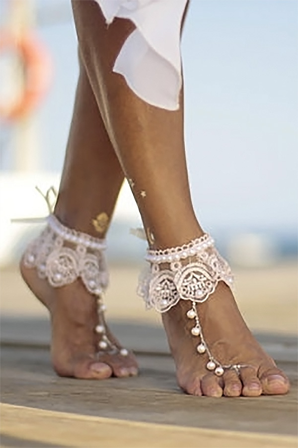 Typically, barefoot sandals have a simple strap. I love that these are unique, with the lace cuff. There's a boho, gypsy vibe but still would work in an elegant wedding. They are the second or third listing on the page. #BarefootSandals #BeachWedding #MyOnlineWeddingHelp #BohoWedding #SummerWedding