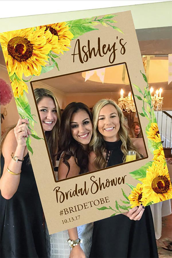 Great Summer bridal shower or wedding photo booth idea. Use a photo prop frame for pics. I love the sunflowers on this one. Roberta sells the PDF file with your info on it (whether it's a wedding, shower, etc., and names and date, wedding hashtag, etc). Then you DIY the frame. OR just let her do the whole thing. Look at the first listing on the page for more info or to buy. #BridalShower #PhotoBooth #MyOnlineWeddingHelp #WeddingPhotoBooth