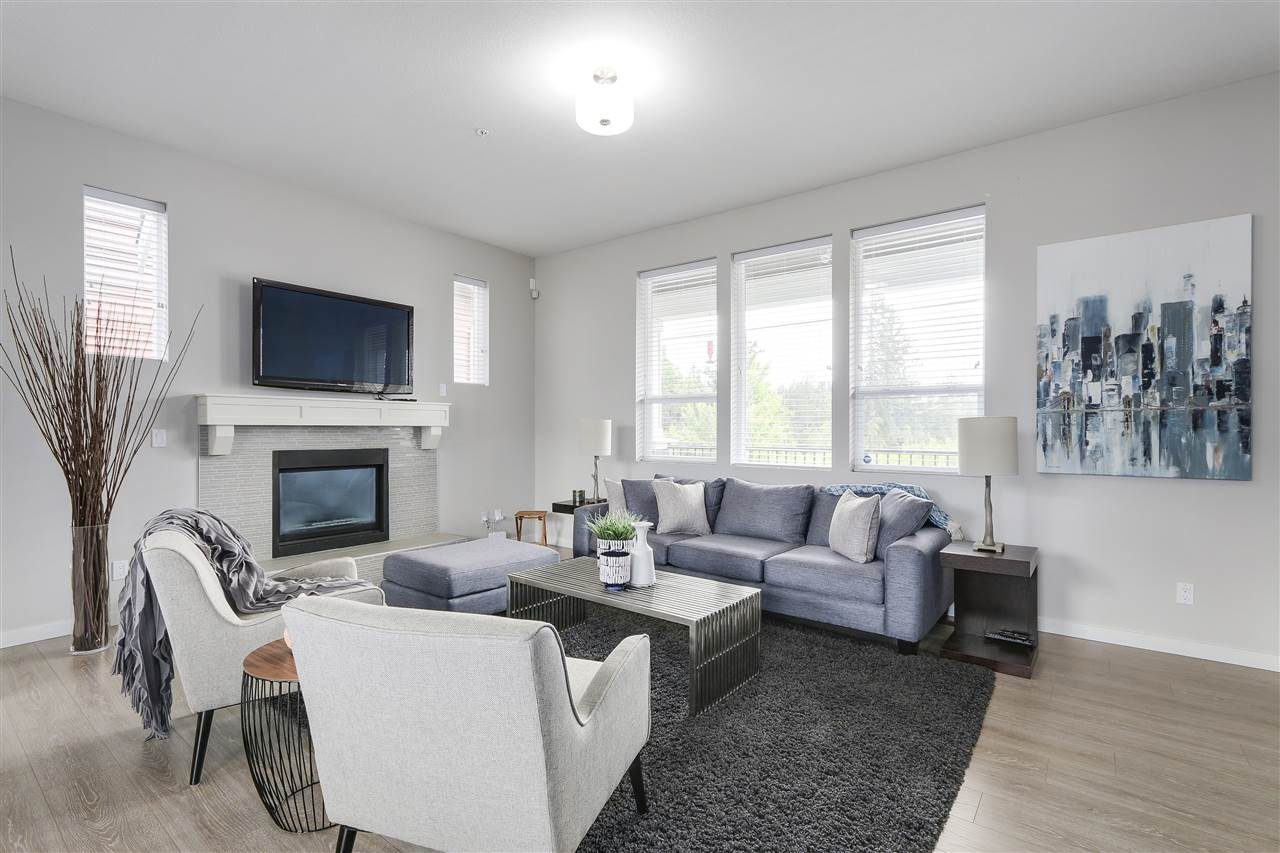 Spacious living room featuring natural gas fireplace