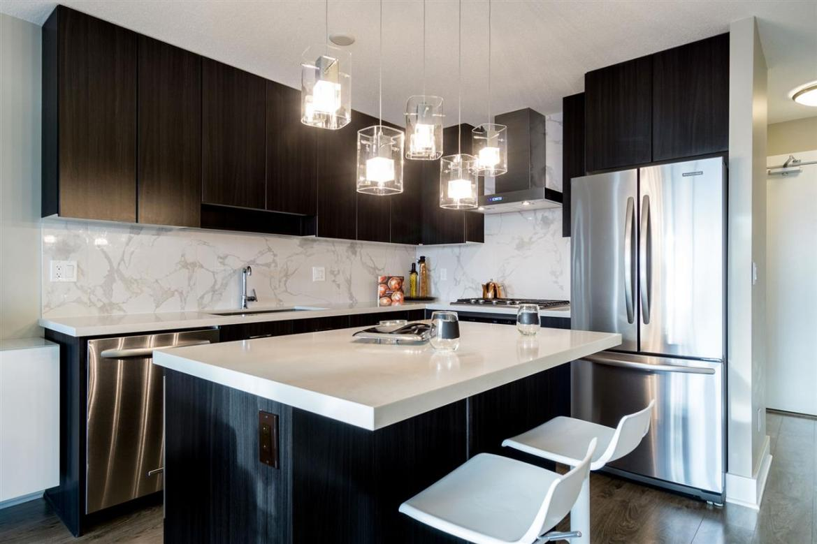 Live in Luxury at Aviara - Expertly designed open-concept kitchen w/ generous sized island and bar area