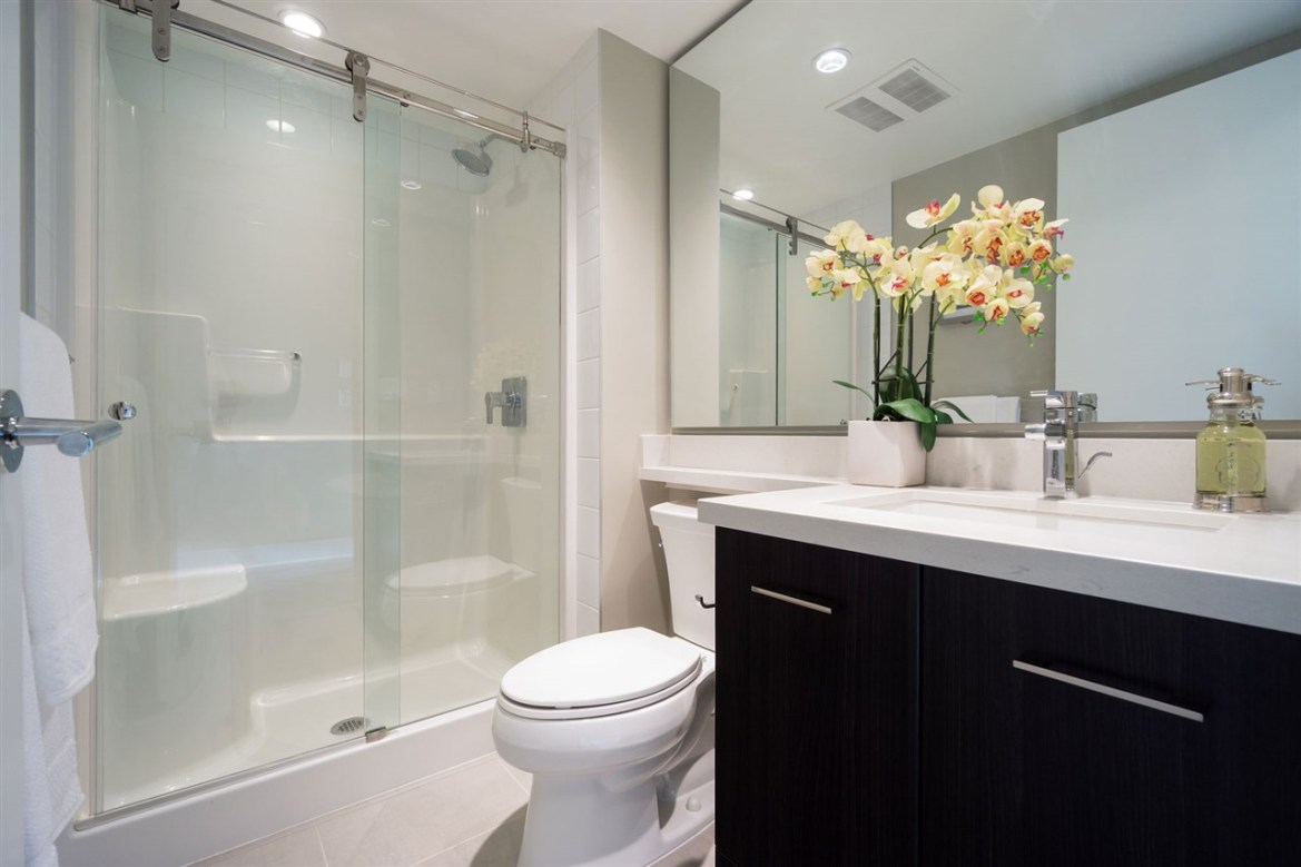 Live in Luxury at Aviara - Guest Bathroom sports a clean finish w/ large wall sized mirror