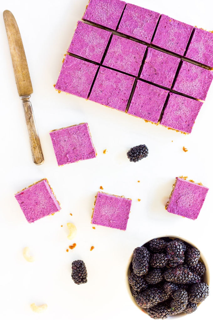These Raw Vegan BlackBerry Cheesecake bars are super creamy and perfectly sweet. This easy no-bake dessert is also extremely healthy! You would never believe it's dessert by simply looking at the nutritional values. This recipe is also Paleo, Gluten-free, Egg-free, Flourless and Dairy-Free! | onecleverchef.com