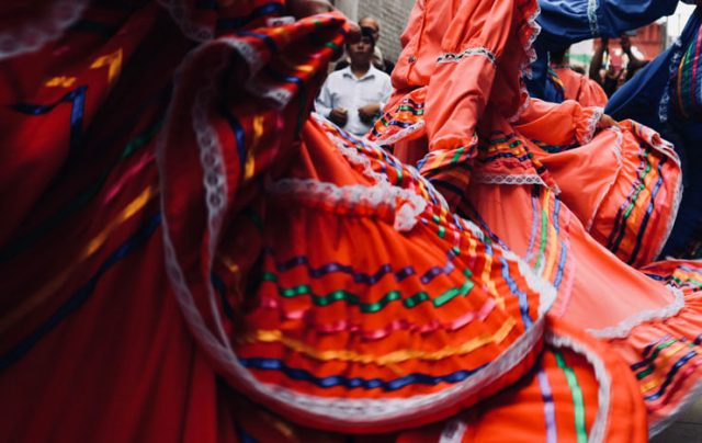 Colorful skirts of women dancing