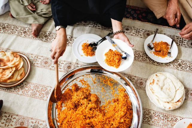 Hands serving rice