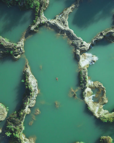 Birds-eye view of a person floating in Salto Del Agua
