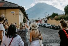 A group of female photographers walking around in Latin America
