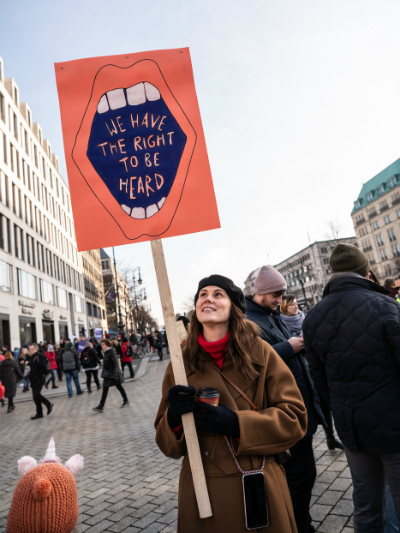 Feminism in the travel space: a woman marches in Berlin.