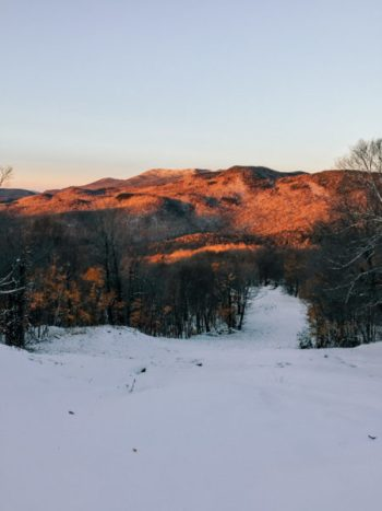 A ski slope in Vermont at sunset