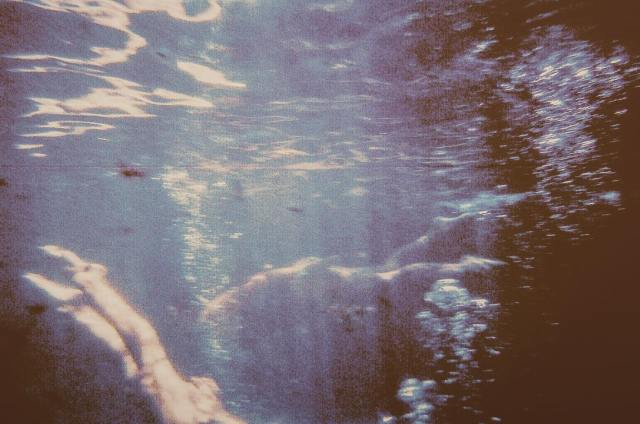 A film photograph of an abstract underwater scene