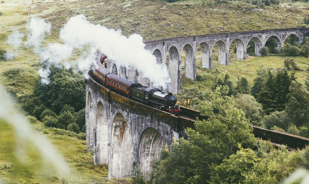 A train crosses the Glenfinnan Viaduct in Scotland.