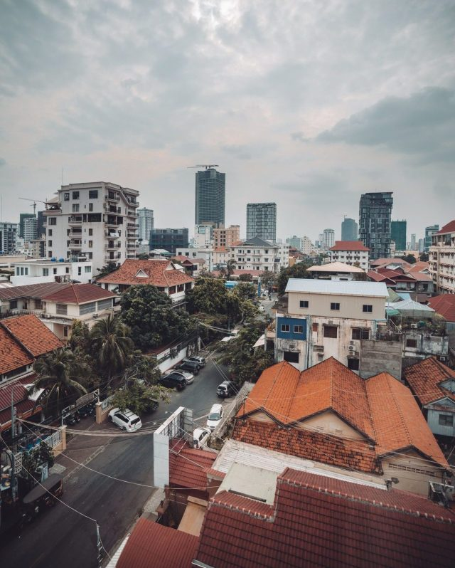 A view overlooking colorful rooftops in Cambodia