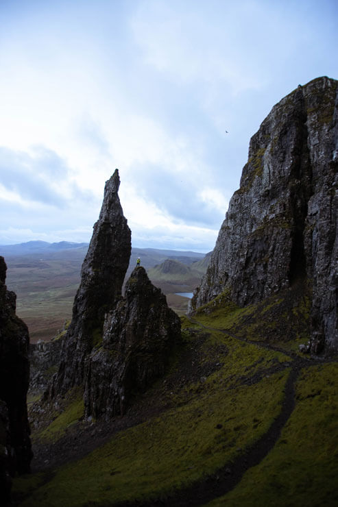 Person in front of the Needle of the Isle of Skye in Scotland.