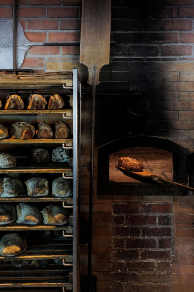 Sourdough bread being baked in a wood-fire oven in Singapore's Katong/Joo Chiat neighborhood