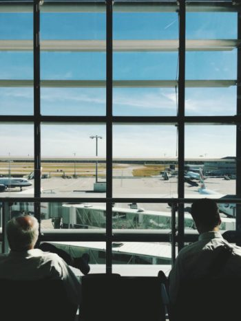 Two men sitting in an airport